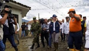 Patru morți și 19 dispăruți în urma unei alunecări de teren