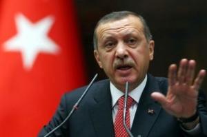 Recep Erdogan o acuză pe Angela Merkel că susţine