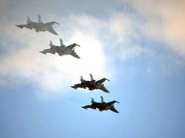 Patru avioane ruseşti în spaţiul aerian NATO