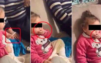"""Fetiţă de 3 ani pusă de familie să fumeze şi să bea: """"Aşa, stai ca barosanii!"""""""