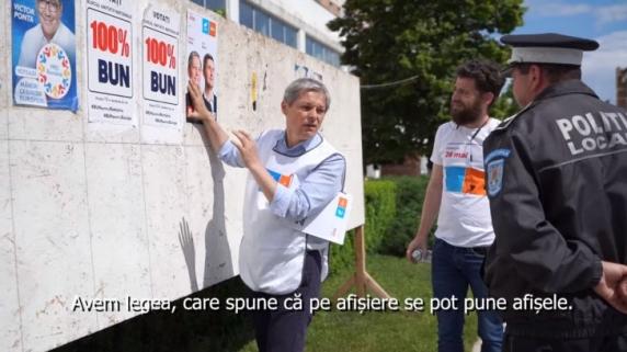 Dacian Cioloș, chestionat de un polițist local din Teleorman pentru că lipea afișe electorale