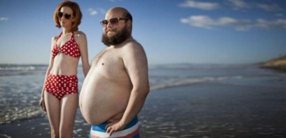 E dovedit stiintific: barbatii cu burta atrag mai multe femei frumoase. Iata explicatia biologica