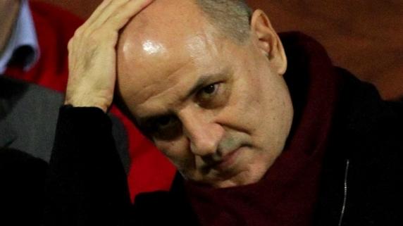 George Copos, fostul patron al Rapidului, a fost trimis în judecată din cauza unei cărți pe care susține că a scris-o în închisoare